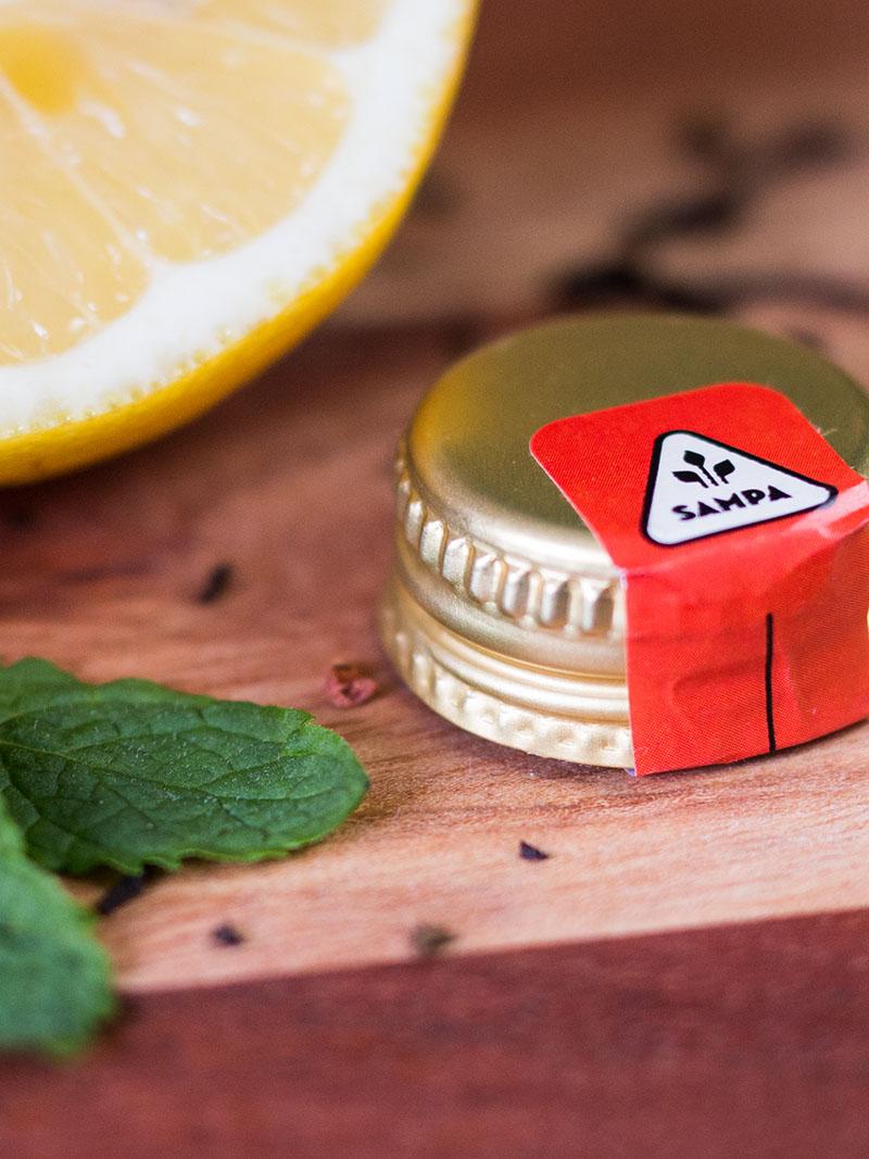 detail of iced tea bottle design drop cap branding